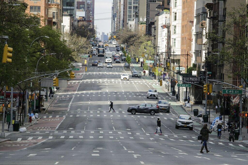 Pedestrians cross second avenue in New York City. (AP Photo/Frank Franklin II)