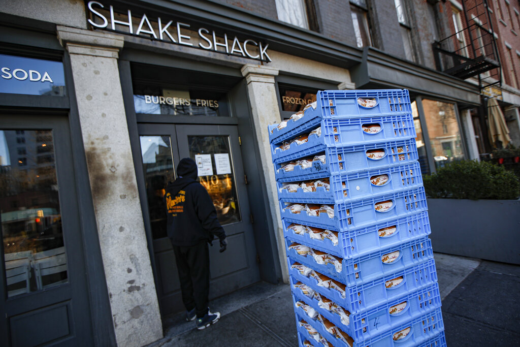 A bread delivery is made to a Shake Shack restaurant in the Brooklyn borough of New York. The burger chain Shake Shack says it will return a small-business loan it got to help weather the coronavirus crisis after topping up its funding. (AP Photo/John Minchillo, File)