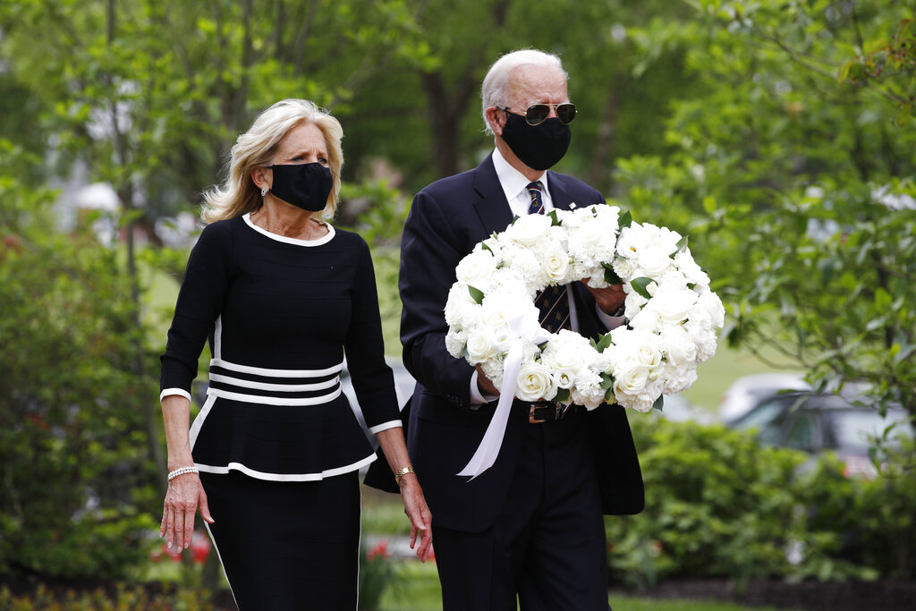 Joe Biden and Jill Biden arrive to lay a wreath at the Delaware Memorial Bridge Veterans Memorial Park, Monday, May 25, 2020, in New Castle, Del. (AP Photo/Patrick Semansky)