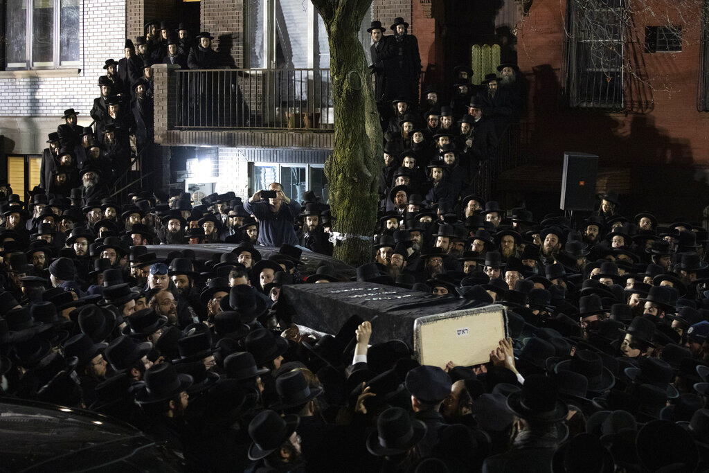 Orthodox Jewish men carry Moshe Deutsch's casket outside a Brooklyn synagogue following his funeral in New York. Deutsch was killed in a shooting inside a Jersey City, N.J., kosher food market. Authorities said the attackers, David Anderson and Francine Graham, were motivated by a hatred of Jewish people and law enforcement. (AP Photo/Mark Lennihan, File)