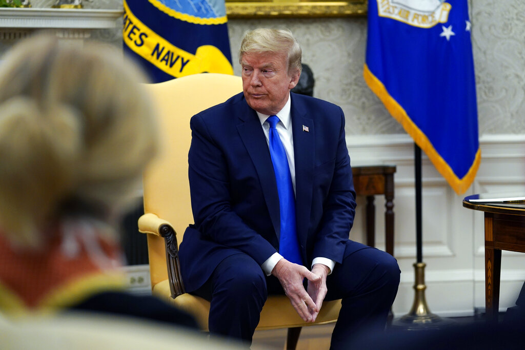 President Donald Trump listens during a meeting with Iowa Gov. Kim Reynolds in the Oval Office of the White House, Wednesday, May 6, 2020, in Washington. (AP Photo/Evan Vucci)
