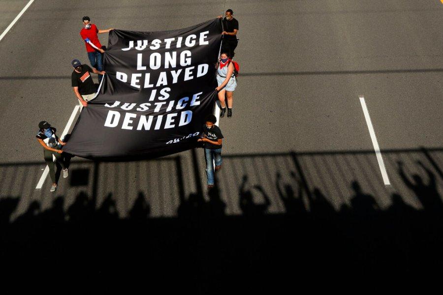 Demonstrators march along an interstate in Minneapolis. (AP Photo/Julio Cortez)
