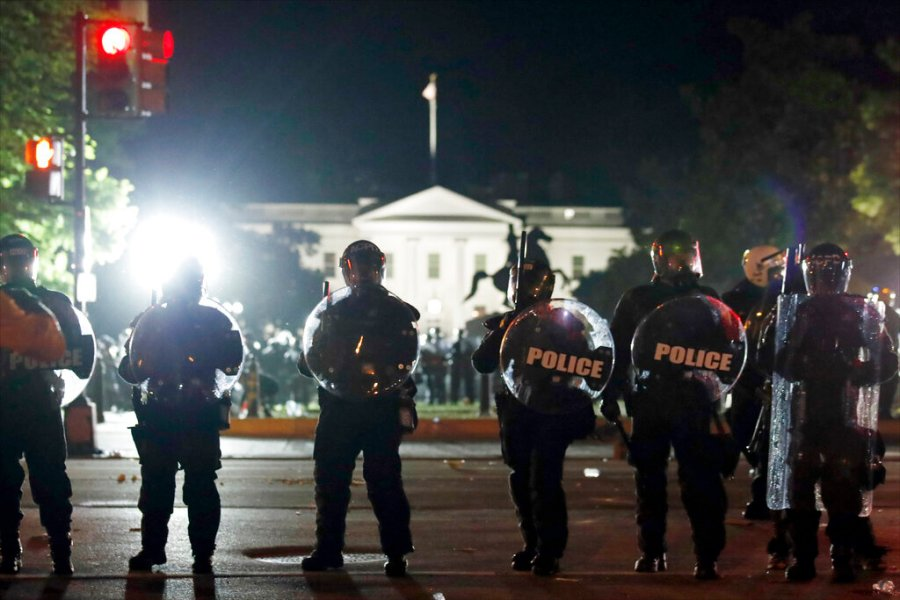 Police form a line on H Street as demonstrators gather to protest near the White House in Washington, DC. (AP Photo/Alex Brandon)