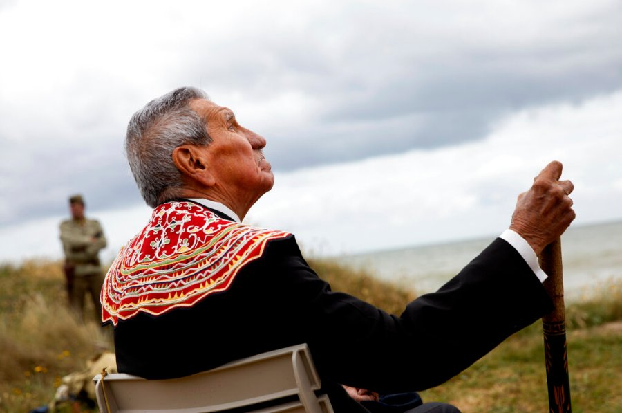 World War II D-Day veteran and Penobscot Elder from Maine, Charles Norman Shay participates in a Native American ceremony  overlooking Omaha Beach in Saint-Laurent-sur-Mer, Normandy, France, Friday, June 5, 2020. Saturday's anniversary of D-Day will be one of the loneliest remembrances ever, as the coronavirus pandemic is keeping almost everyone away, from government leaders to frail veterans who might not get another chance for a final farewell to their unlucky comrades. (AP Photo/Virginia Mayo)