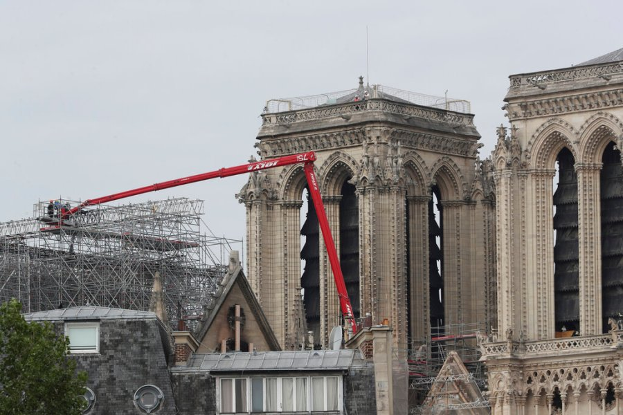 Workers start removing the scaffolding at Notre Dame cathedral in Paris. Workers suspended from ropes will be lowered into the charred remains of scaffolding that melted atop Notre Dame when the cathedral went up in flames and begin the delicate job of dismantling the 200 tons of metal. (AP Photo/Thibault Camus)