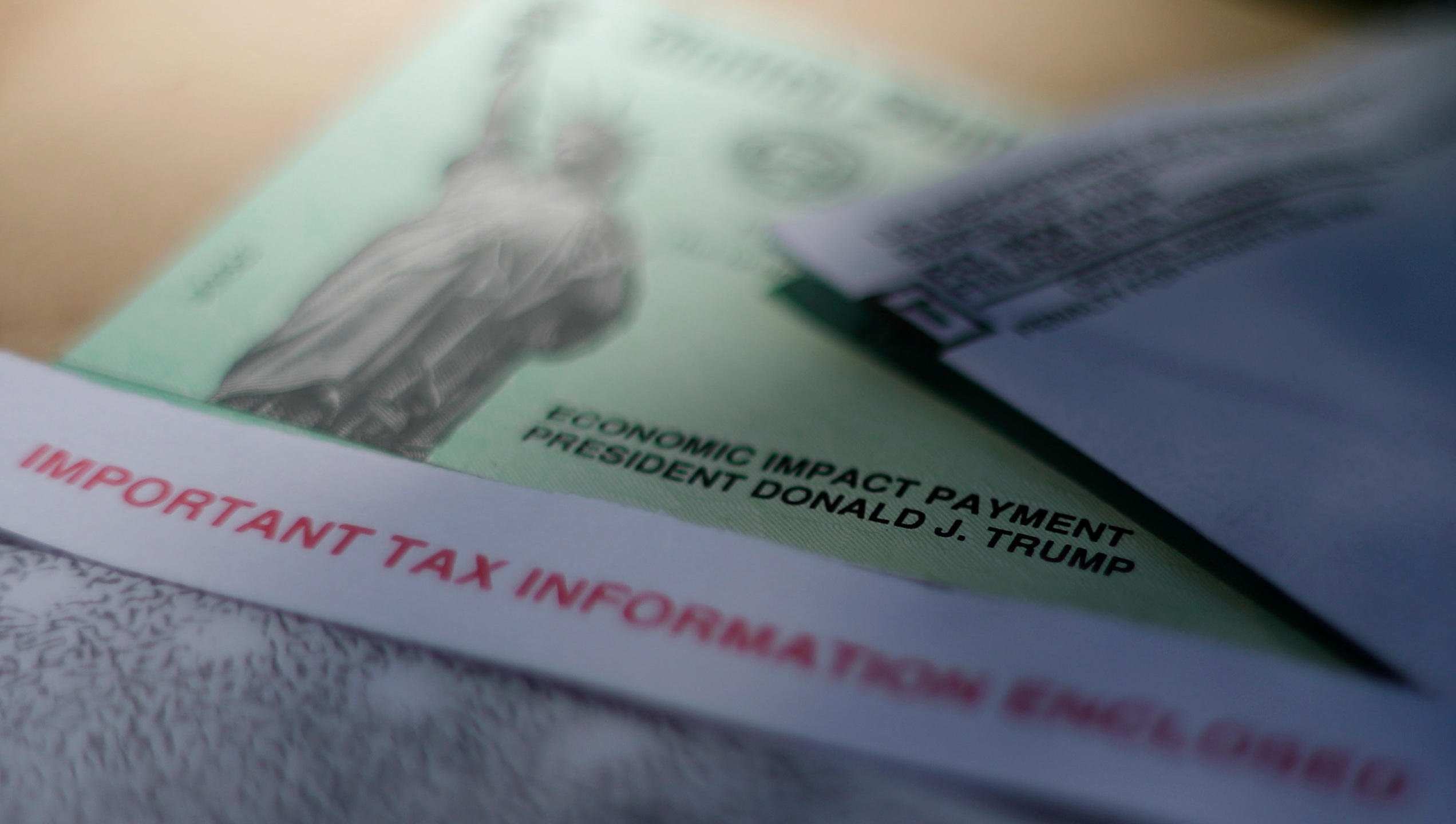 President Donald J. Trump's name is printed on a stimulus check issued by the IRS to help combat the adverse economic effects of the new coronavirus outbreak in San Antonio. (AP Photo/Eric Gay, File)