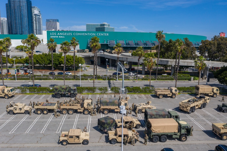 A drone aerial view shows California National Guard troops gathered at the Los Angeles Convention Center after being activated by California Governor Gavin Newsom following violent demonstrations in response to George Floyd's death. (Photo by David McNew/Getty Images)
