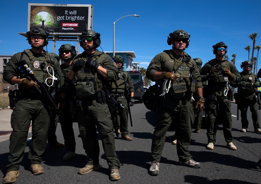 Huntington Beach SWAT team members stand ready for protesters after violent demonstrations in response to George Floyd's death on May 31, 2020 in Huntington Beach, California. (Photo by Brent Stirton/Getty Images)