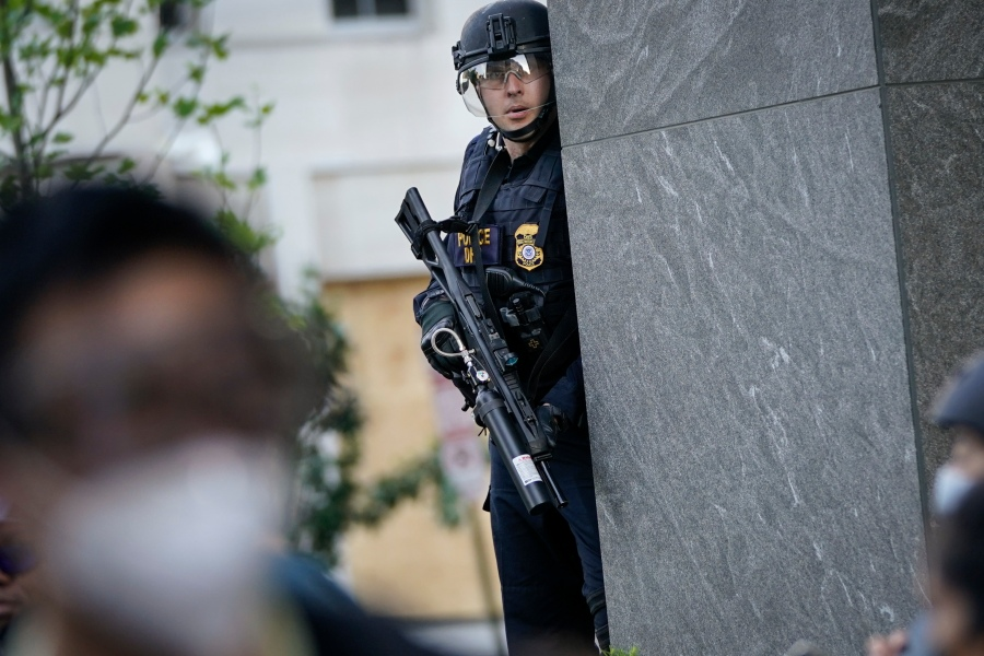 Law enforcement officers monitor a protest in downtown Washington, DC.  (Photo by Drew Angerer/Getty Images)