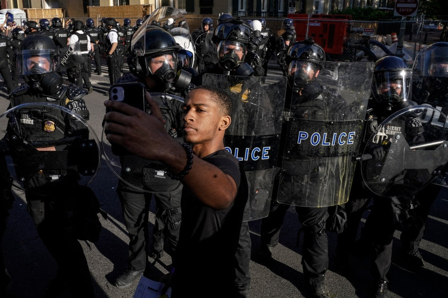 Demonstrators confront law enforcement during a protest in downtown Washington, DC. (Photo by Drew Angerer/Getty Images)