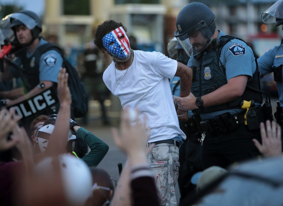 A demonstrator is arrested during a protest against police brutality and the death of George Floyd, on May 31, 2020 in Minneapolis, Minnesota. (Photo by Scott Olson/Getty Images)