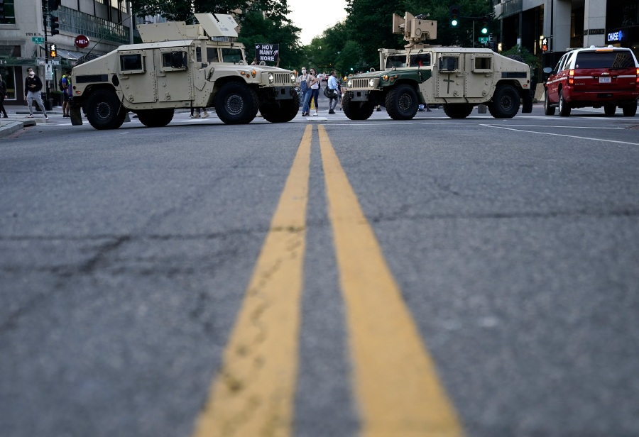 Two military humvees block a roadway near the White House.  (Photo by Drew Angerer/Getty Images)