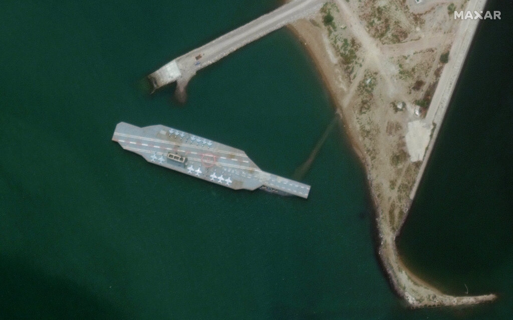 A fake aircraft carrier is seen off the coast of Bandar Abbas, Iran, In this June 7, 2020 satellite photo provided by Maxar Technologies. As tensions remain high between Iran and the U.S., the Islamic Republic appears to have constructed a new mockup of an aircraft carrier off its southern coast for potential live-fire drills. (Satellite image ©2020 Maxar Technologies via AP)