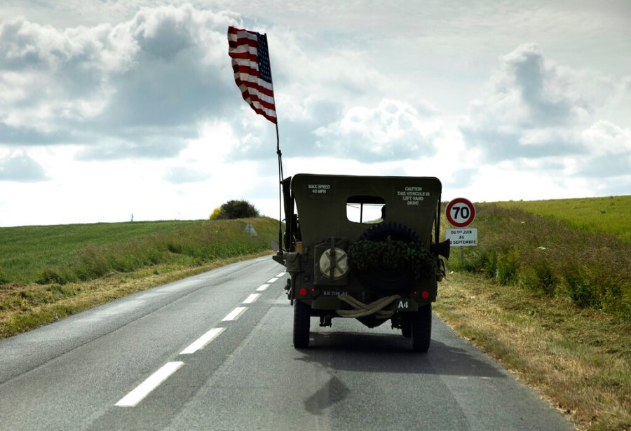 A US flag flies on the back of a WWII era US Army Jeep in Grandcamp Maisy, Normandy, France on Thursday, June 4, 2020. In sharp contrast to the 75th anniversary of D-Day, this year's 76th will be one of the loneliest remembrances ever, as the coronavirus pandemic is keeping nearly everyone from traveling. (AP Photo/Virginia Mayo)