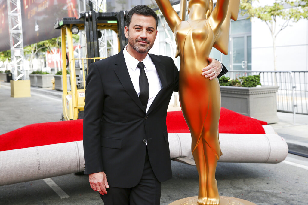 Jimmy Kimmel poses for a photo with a replica of an Emmy statue at the Primetime Emmy Awards in 2016. Kimmel will return as host and will serve as executive producer for the 72nd Emmy Awards. The show will be broadcast, Sunday, Sept. 20, on ABC. (Photo by Rich Fury/Invision/AP, File)