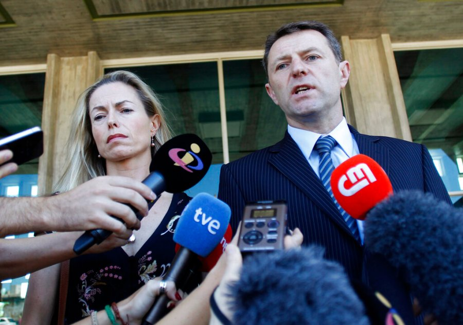 Kate McCann, left, and Gerry McCann, the parents of missing British girl Madeleine McCann, talk to the media outside a court in Lisbon in 2014. Madeleine McCann's family is hoping for closure in the case after a key suspect was identified in Germany and as authorities there say they believe the missing British girl is dead. (AP Photo/Francisco Seco, File)