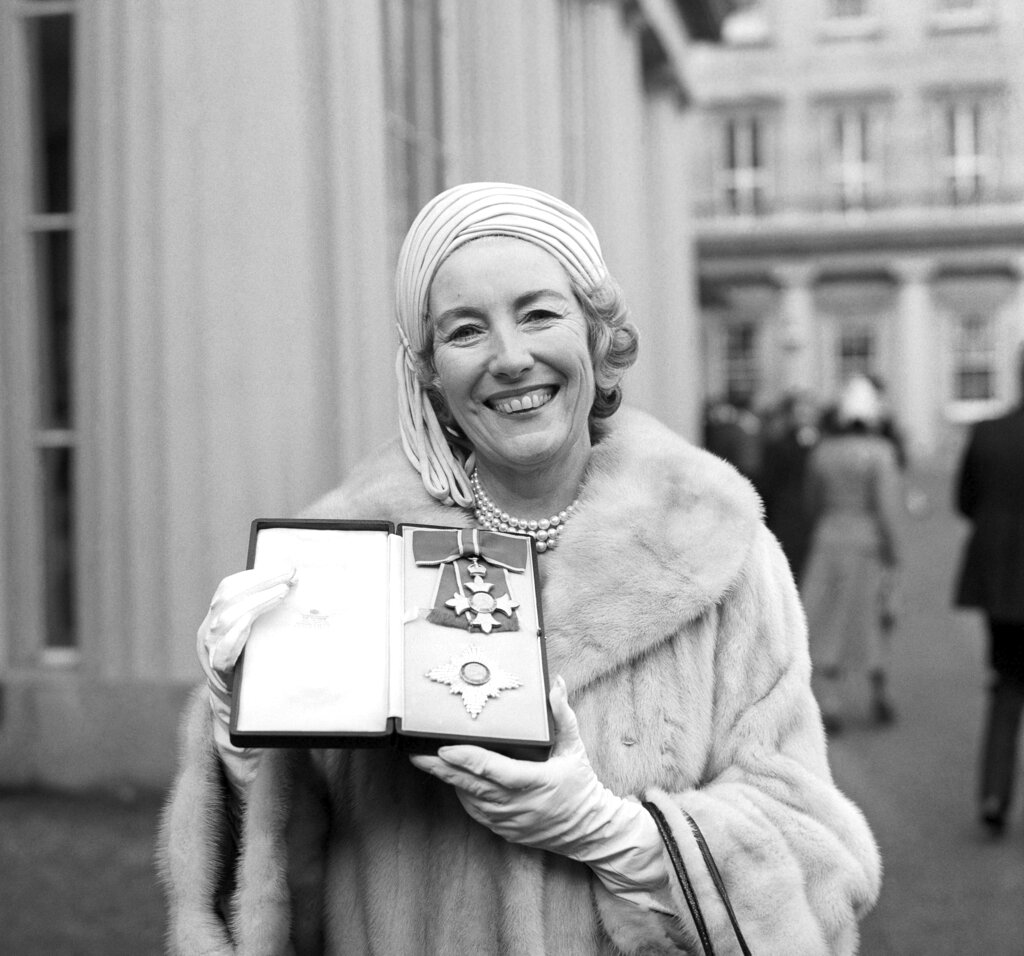 In this Dec. 2, 1975 file photo, singer Vera Lynn poses outside Buckingham Palace after being invested a Dame Commander of the British Empire. The family of World War II forces sweetheart Vera Lynn says she has died at 103. (PA via AP, File)