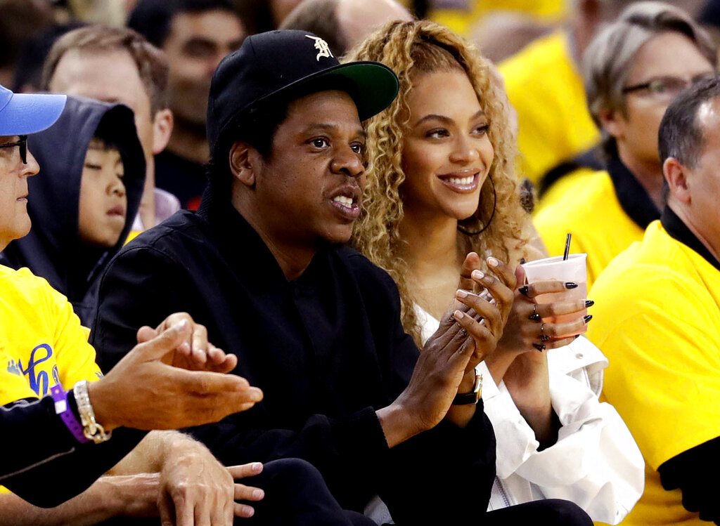 Jay-Z and Beyonce watch Game 1 of an NBA basketball second-round playoff series between the Golden State Warriors and the New Orleans Pelicans in 2018. Several top record labels organized Black Out Tuesday on June 2, 2020 as riots erupted around the world sparked by George Floyd's death as well as the killings of Ahmaud Arbery and Breonna Taylor. Musicians including Rihanna, Beyoncé, Taylor Swift, Lil Nas X, Demi Lovato, Post Malone and Harry Styles have spoken out following Floyd's death and the worldwide riots. (AP Photo/Marcio Jose Sanchez, File)