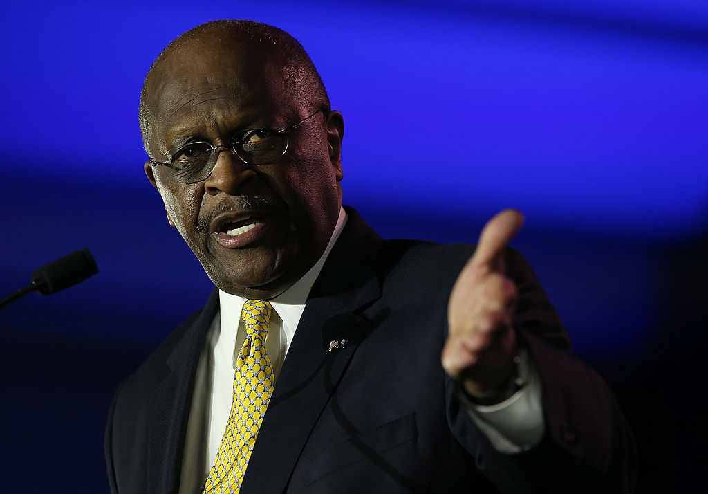 FILE: Herman Cain, former chairman and chief executive officer of Godfather's Pizza, speaks during the final day of the 2014 Republican Leadership Conference on May 31, 2014 in New Orleans, Louisiana. (Photo by Justin Sullivan/Getty Images)