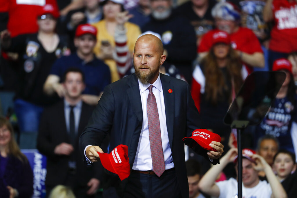 """Brad Parscale throws """"Make America Great Again,"""" hats to the audience before a rally in Grand Rapids, Mich. Trump is shaking up his campaign amid sinking poll numbers, replacing Parscale with veteran GOP operative Bill Stepien. Trump and Parscale's relationship had been strained since a Tulsa, Okla., rally that drew a dismal crowd, infuriating the president. (AP Photo/Paul Sancya, File)"""