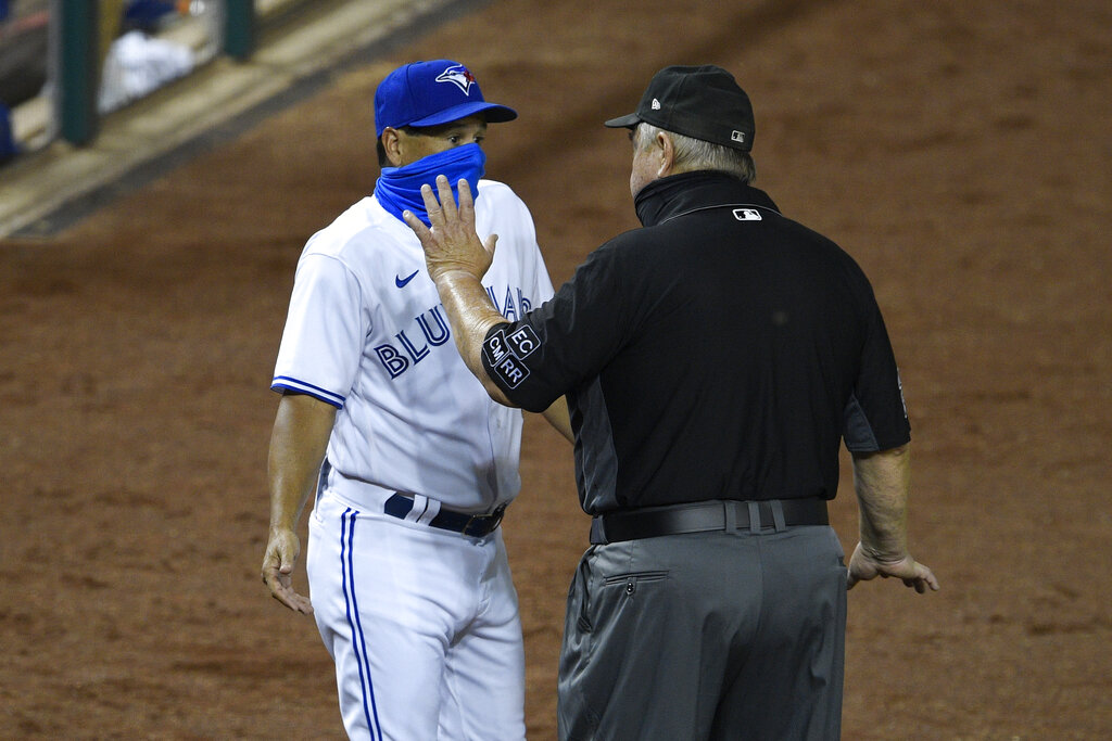 Toronto Blue Jays manager Charlie Montoyo talks with first base umpire Joe West after Rowdy Tellez was ejected during the tenth inning of a baseball game against the Washington Nationals on Wednesday. (AP Photo/Nick Wass)