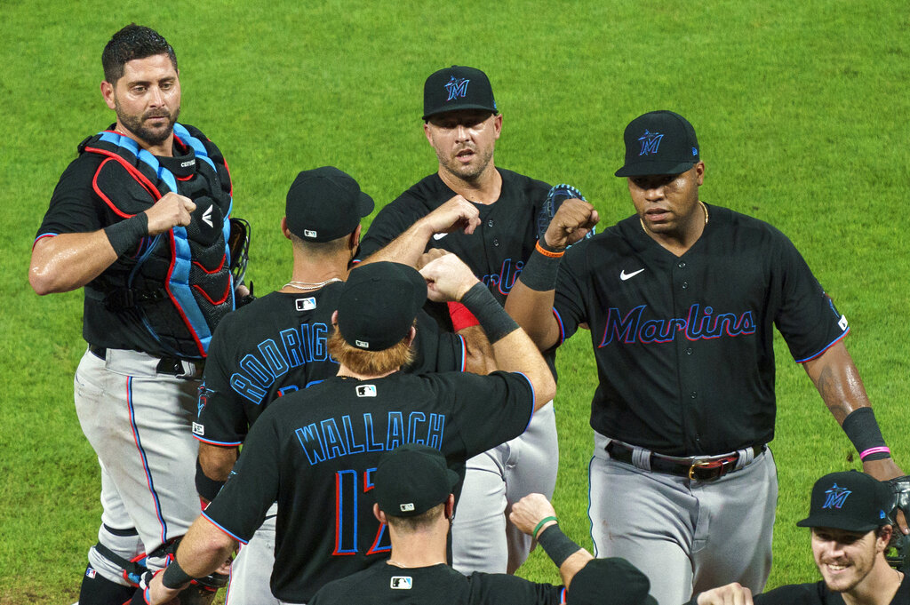 Miami Marlins' Jesus Aguilar, right, celebrates a 5-2 win over the Phillies with teammates on July 24th.. The Marlins' coronavirus outbreak could endanger the Major League Baseball season, Dr. Anthony Fauci said, as the number of their players testing positive rose to 15. The Marlins received positive test results for four additional players Tuesday. (AP Photo/Chris Szagola, File)
