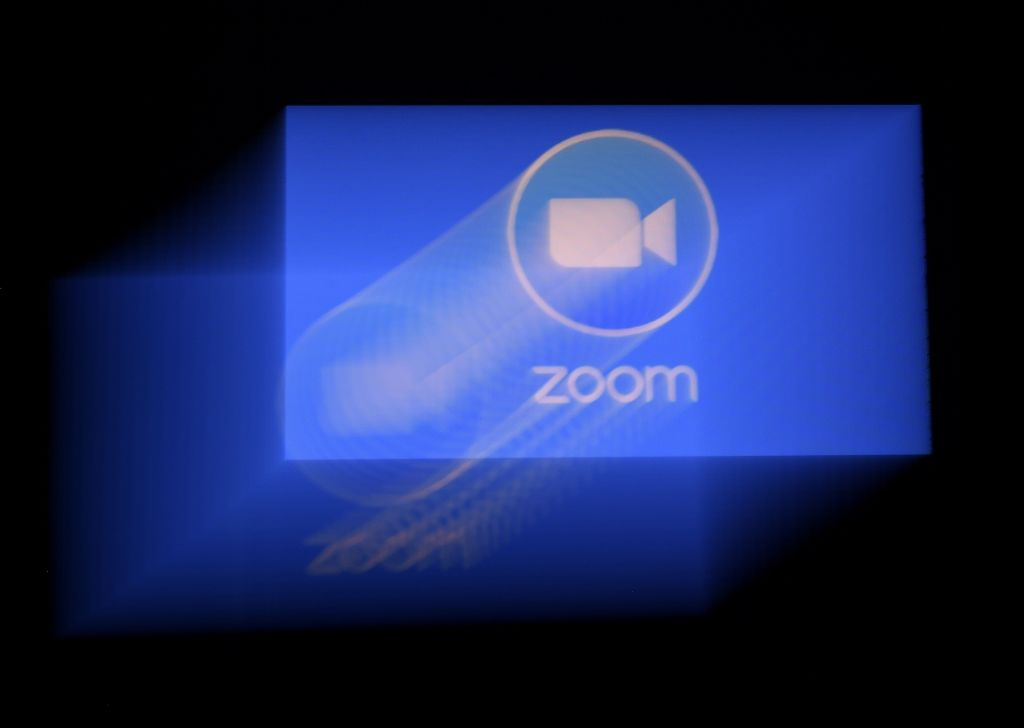 The Zoom video meeting and chat app has become the wildly popular host to millions of people working and studying from home during the coronavirus outbreak. (Photo by OLIVIER DOULIERY/AFP via Getty Images)