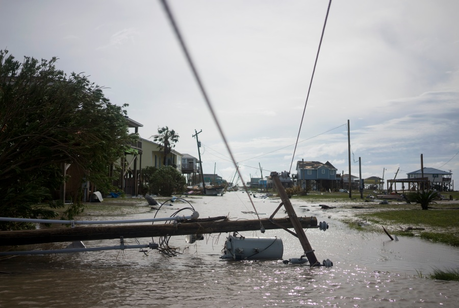 Damaged homes sit in flood water  in Holly Beach, Louisiana. (Photo by Eric Thayer/Getty Images)