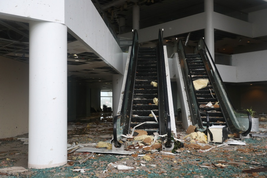 An escalator is seen in a building that had its windows blown in the downtown area of Lake Charles, La. (Photo by Joe Raedle/Getty Images)