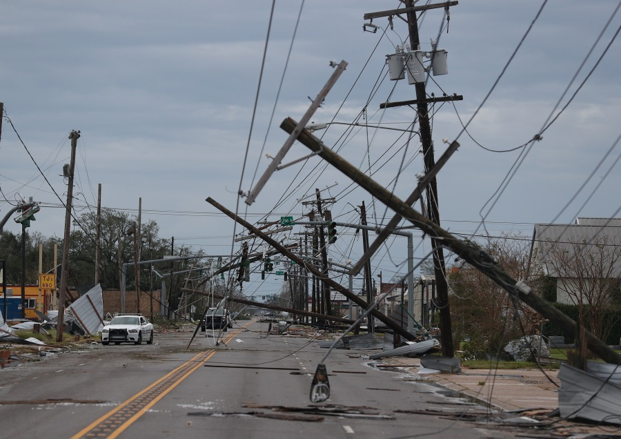 A street is strewn with debris and downed power lines in Lake Charles, Louisiana . (Photo by Joe Raedle/Getty Images)