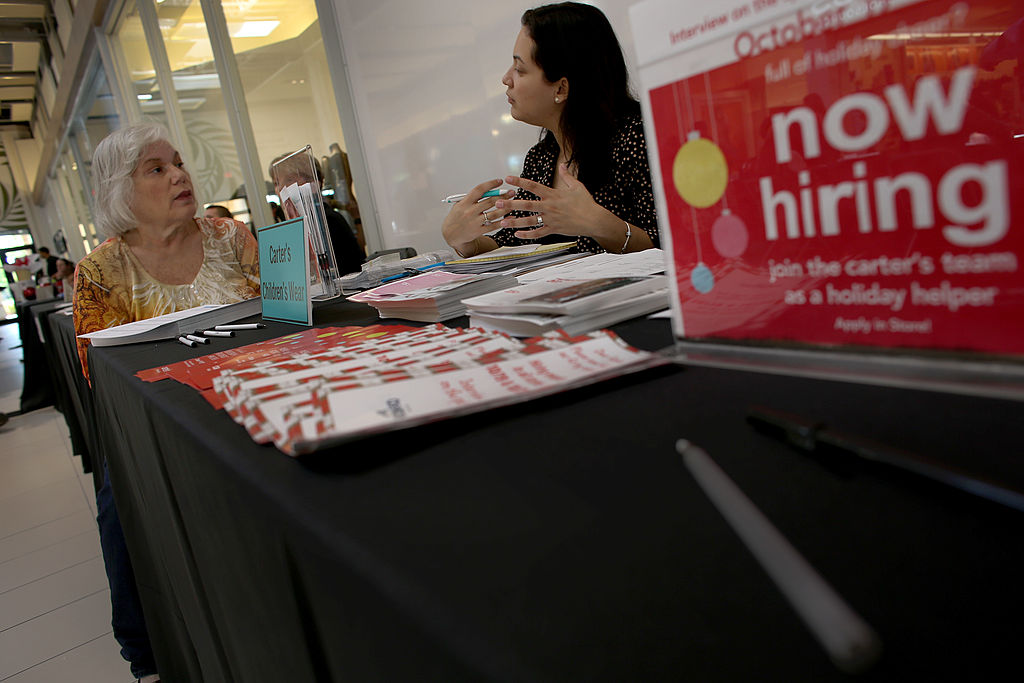 Bonnie Altwerger sits for a job interview with Jessica Cortes as she looks for part time work at Carter's Children's Wear during a job fair in Sunrise, Florida. (Photo by Joe Raedle/Getty Images)