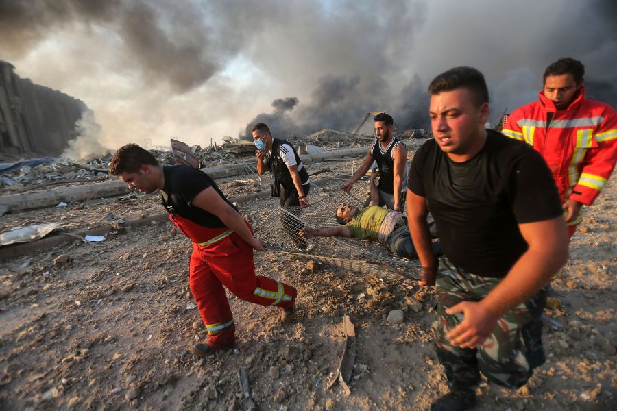 Firefighters evacuate a wounded man from the scene of an explosion at the port in Beirut.