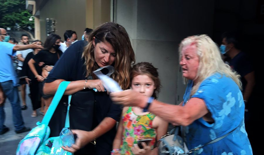 Valarie Fakhoury, a British grandmother with her Lebanese daughter and granddaughter, stand outside the emergency ward of a hospital in central Beirut following a huge explosion.