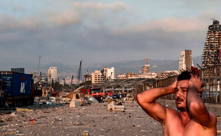 A man reacts at the scene of an explosion at the port in Lebanon's capital Beirut.