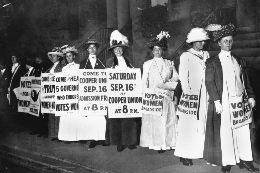 In this September 1916 file photo, demonstrators hold a rally for women's suffrage in New York. The Seneca Falls convention in 1848 is widely viewed as the launch of the women's suffrage movement, yet women didn't gain the right to vote until ratification of the 19th Amendment in 1920. (AP Photo/File)