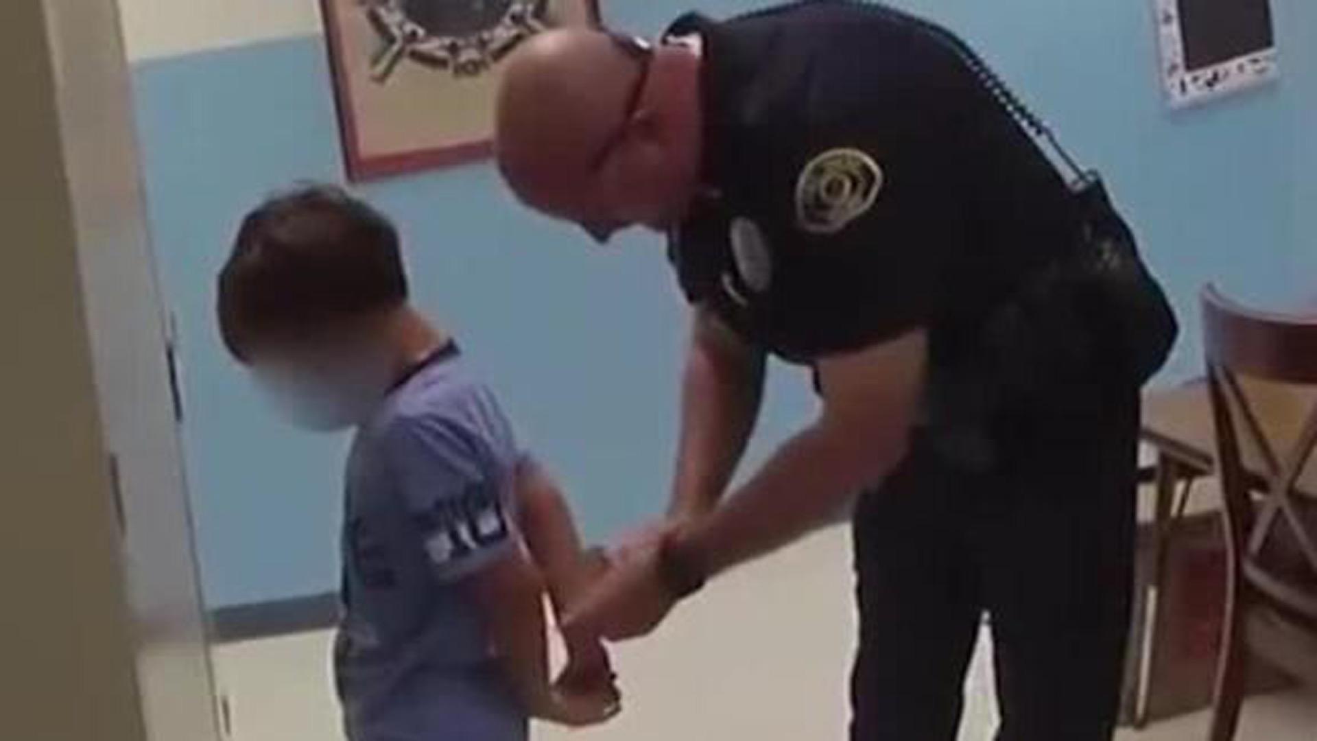 Boy handcuffed