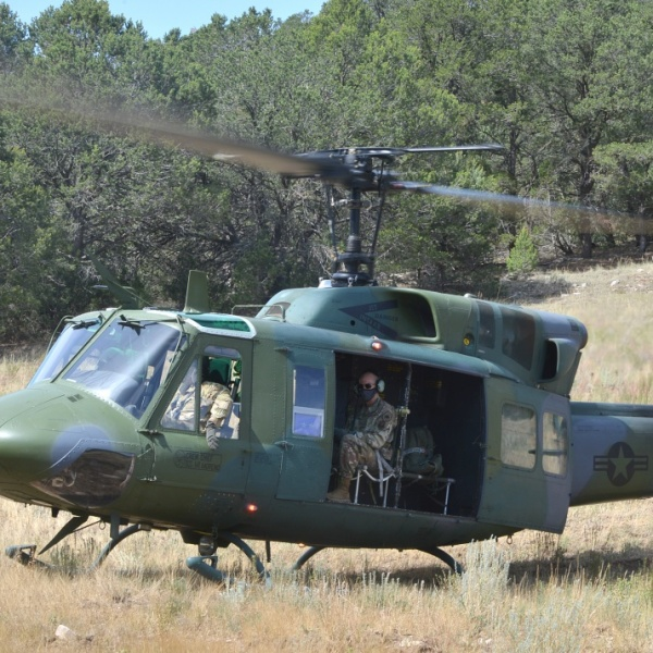 U.S. Air Force Maj. Gen. Michael J. Lutton is transported in a UH-1N Huey, provided by the 58th Special Operations Wing, to a location on Kirtland Air Force Base, New Mexico, in July. (U.S. Air Force photo by Todd Berenger)