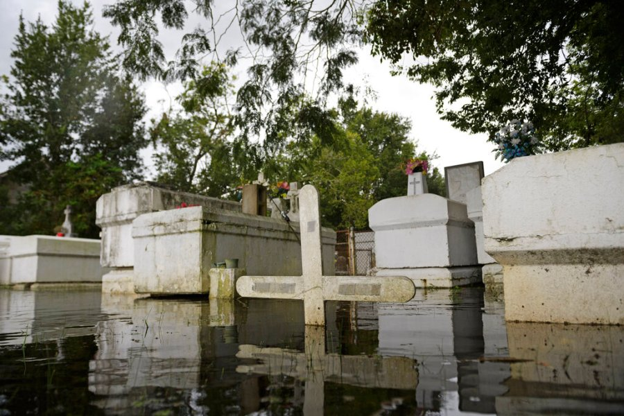 A cemetery along Privateer Blvd. in Barataria, La. is inundated in water as water levels surge before Hurricane Laura on, Wednesday in Barataria, La. (Max Becherer/The Advocate via AP)