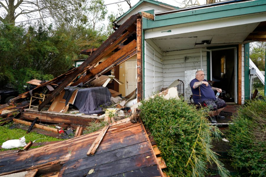 Chris Johnson views destruction at his home in Lake Charles, La., after Hurricane Laura moved through the state. Johnson stayed in his home as the storm passed. (AP Photo/Gerald Herbert)
