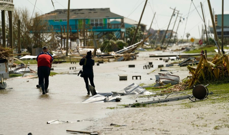 Journalists examine damage left in the wake of Hurricane Laura in Holly Beach, La. (AP Photo/Eric Gay)