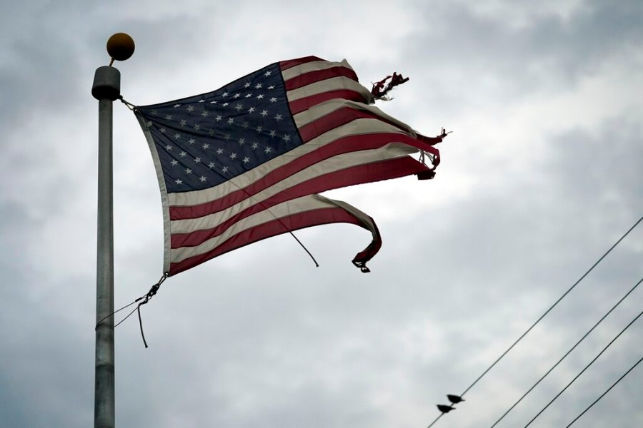 A tattered American flag blows in the wind in the aftermath of Hurricane Laura in Port Arthur, Texas. (AP Photo/Eric Gay)