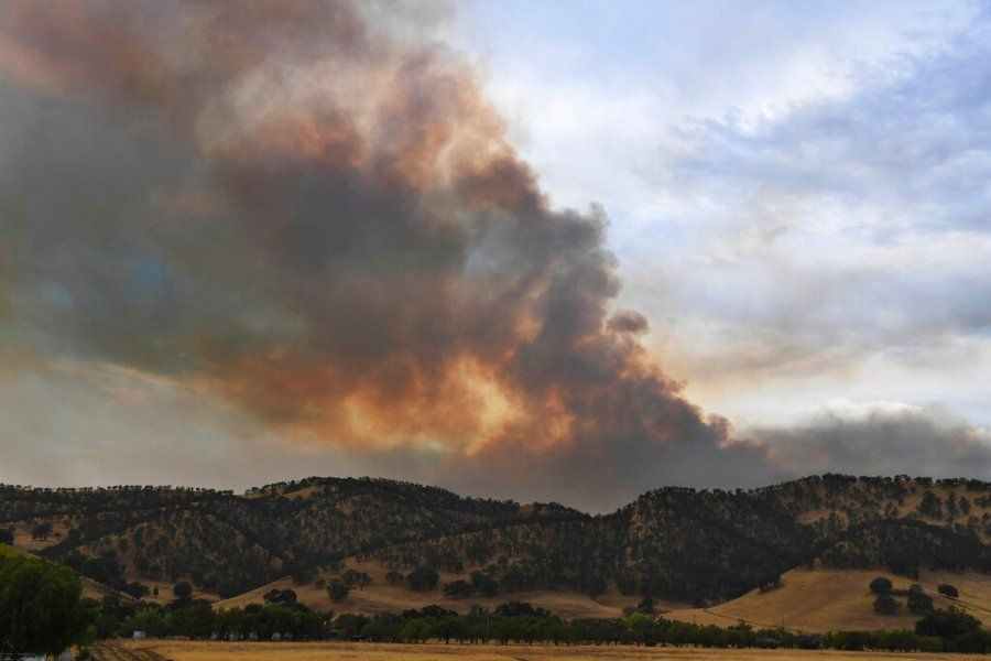 Smoke from a vegetation fire caused by a lightning strike rises into the sky as seen from Marsh Creek Road in Brentwood, Calif., on Sunday. (Jose Carlos Fajardo/Bay Area News Group)