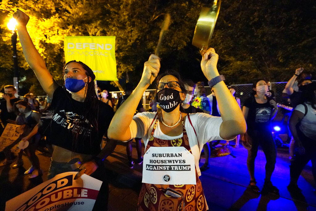 Trump protestors rally, Thursday night outside the White House.. (AP Photo/Carolyn Kaster)