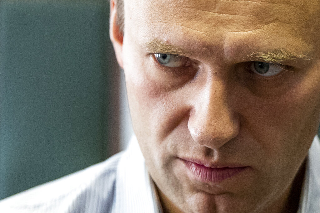 Russian opposition leader Alexei Navalny stands during a break in the hearing on his appeal in a court in Moscow, Russia in 2018. Navalny was placed on a ventilator in a hospital intensive care unit in Siberia after falling ill from suspected poisoning during a flight, his spokeswoman said Thursday. (AP Photo/Pavel Golovkin, File)