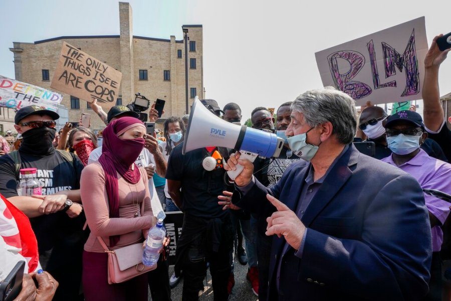 Kenosha Mayor John Antaramian, right, speaks to protesters using a megaphone on Monday. (AP Photo/Morry Gash)