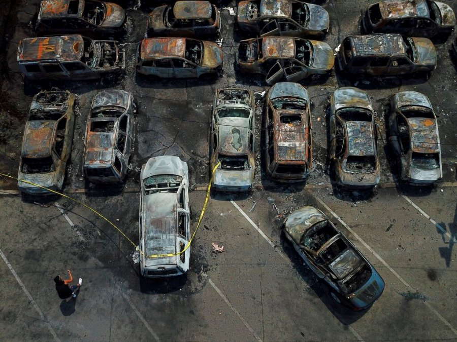Burned out vehicles are seen Monday in Kenosha, Wis. Many of the cars were set on fire during protests Sunday night after a police shooting in the city. (AP Photo/Morry Gash)