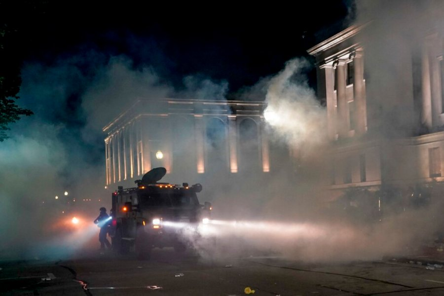 Police clash with protesters near the Kenosha County Courthouse, Monday, Aug. 24, 2020, in Kenosha, Wis. (AP Photo/Morry Gash)