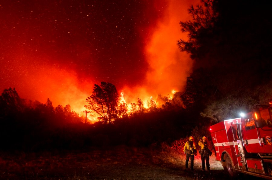 Firefighters watch the Bear Fire approach in Oroville, Calif., on Wednesday. (AP Photo/Noah Berger)