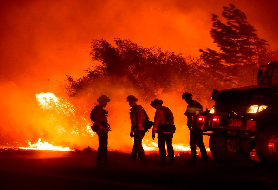 Firefighters monitor the Bear Fire burning in Oroville, Calif., on Wednesday. (AP Photo/Noah Berger)
