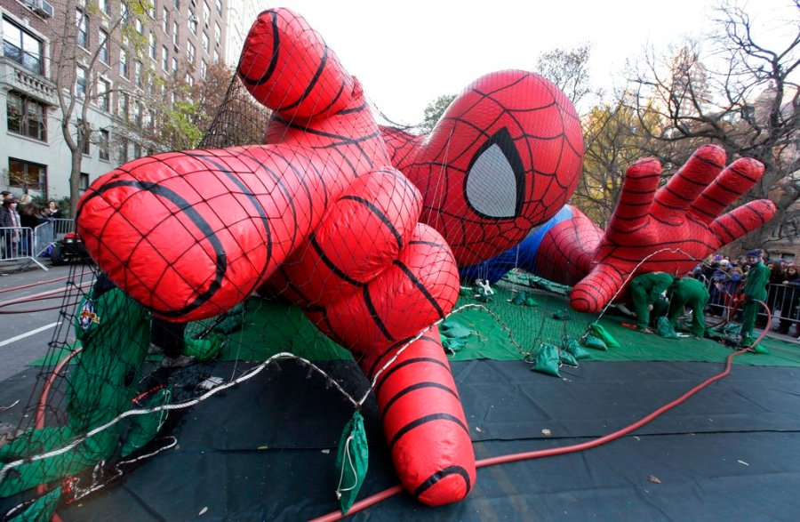 Workers inflate the Spider-Man balloon for the annual Macy's Thanksgiving Day Parade in 2017. (AP Photo/Richard Drew, File)